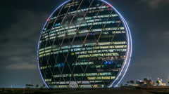 The Aldar headquarters building night timelapse is the first circular building Stock Footage