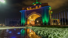 Colorful fountain at the gate to Emirates Palace night timelapse, UAE Stock Footage