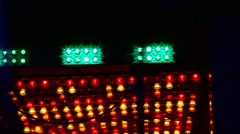 Fun Fair at night flickering lights red orange - stock footage