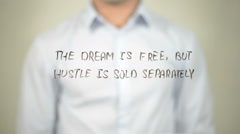 The Dream is Free, But the Hustle is Sold Separately, writing on screen Stock Footage
