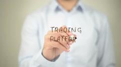 Trading Platform, man writing on transparent screen - stock footage
