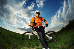 Cyclist with  the Bike on meadow Stock Photos