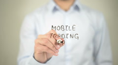Mobile Trading App, man writing on transparent screen Stock Footage