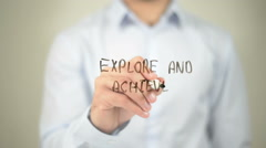 Explore and Achieve, man writing on transparent screen Stock Footage