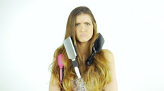 Funny woman with messy long hair unhappy about brushing slow motion Stock Footage