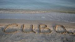 The inscription Cuba on sand, the beach. Stock Footage