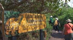Tourists visiting Fausto Llerena Breeding Center, Santa Cruz Island, Galapagos, Stock Footage