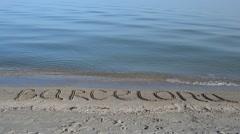 The inscription Barcelona on sand. Stock Footage