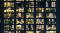 Window of the multi-storey building of glass and steel lighting and people Stock Footage