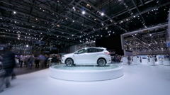 4K rotating car at a motor show / exhibition Stock Footage