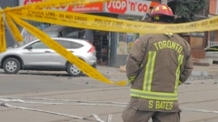 Toronto Fireman Looking Upon Car Crash Crime Scene Stock Footage