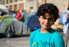Portrait of a Syrian boy in a refugee camp Kuvituskuvat