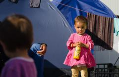 Little Syrian girl in a tent camp for refugee Kuvituskuvat