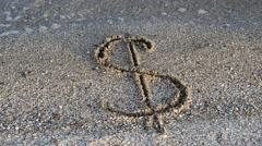Dollar sign on sand. Stock Footage