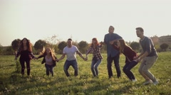 Friends jumping together. Shot in slow motion Stock Footage