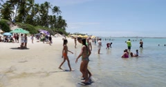 People enjoying a hot day in Porto de Galinhas Stock Footage