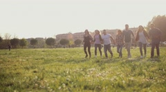 Friends running and jumping together. Shot in slow motion Stock Footage