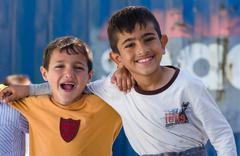 Close Up Syrian boys hugging in the refugee camp Kuvituskuvat