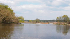 River Flows in Early Spring. the Clouds High Overhead. Fishermen Catch Fish, - stock footage
