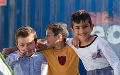 Syrian boys hugging in the refugee camp Kuvituskuvat