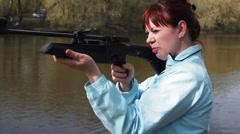 A Woman Aim at the Gun Stock Footage