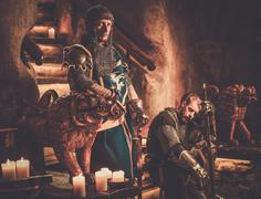 Medieval knights in ancient castle interior. - stock photo