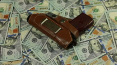 Gun and money concept Stock Footage