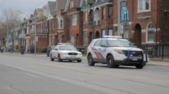 Toronto Police Cars Pan Stock Footage