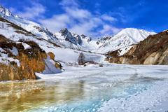 Trail on frozen river in mountains of Eastern Sayan - stock photo