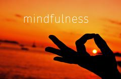 text mindfulness and hand in gyan mudra at sunset - stock photo