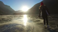 SKATER ON A FROZEN LAKE IN A FANTASTIC SUNSET 1080p Stock Footage
