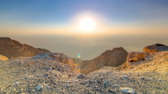 Sunset with rocks timelapse. Jebel Hafeet is a mountain located primarily in the Stock Footage