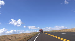 4K Red Semi Country Highway Transportation Scenic - stock footage