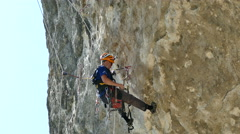 Climber Inspection and Preparation of Clifs to Competition Stock Footage
