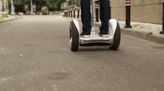 Young person riding on a self-balancing, battery-power electric vehicle. - stock footage