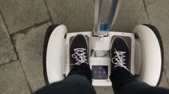 Young person riding on a self-balancing, battery-power electric vehicle Stock Footage