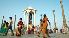 Pondicherry - People by the Gandhi statue in sunset light. Slow motion Stock Footage