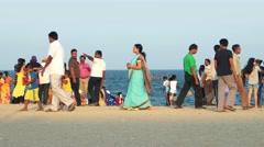 Pondicherry - People walking on Promenade beach in sunset light. 4K - stock footage