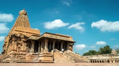 Thanjavur - Time lapse of people visiting Brihadeshwara Temple with blue sky. 4K Stock Footage