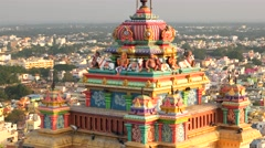 Tiruchirappalli - Hindu temple tower detail with city view and pigeons. 4K Stock Footage