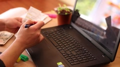 Online Tracking of the expenses with laptop - stock footage