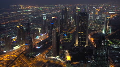 View over skyscrapers lining Sheikh Zayed Road at dusk, Dubai Stock Footage