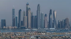Dubai Marina skyline day to night timelapse as seen from atlantis on  Palm Stock Footage