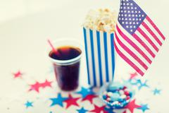 cola and popcorn with candies on independence day - stock photo