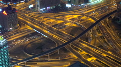 Aerial view of busy highway intersection & junction at night, Dubai - stock footage