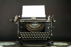 Old and Dusty Typewriter on black background - stock photo