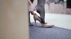 Close-up of hand women trying on shoes on the long heels.  elegant shoes girl Stock Footage