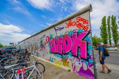 BERLIN, GERMANY - JUNE 06, 2015: Berlin white wall painting with graffitis on - stock photo