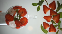 strawberry, mint and ice on a glass surface. flatlay - stock footage