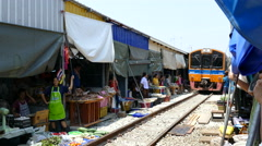 Time lapse from the train passing by at the Maeklong Railway Market Stock Footage